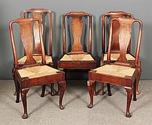 A Harlequin set of five 18th Century walnut dining