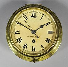 A brass cased ship's bulkhead timepiece, retailed