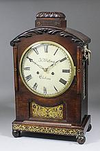 An early 19th Century rosewood and brass inlaid