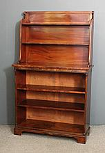 A late Georgian mahogany open front bookcase, the