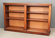 A Victorian mahogany open front bookcase with