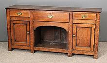 A late 18th Century oak dresser base with plain