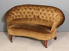 A late Victorian two seat settee with low curved