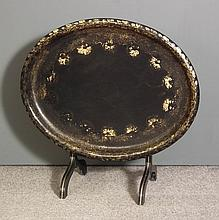 A Victorian papier-mache and gilt decorated oval