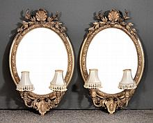 A pair of 19th Century gilt framed oval twin