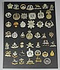 A collection of forty-five differing military cap