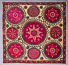 An Uzbek Suzani, woven in colours with nine