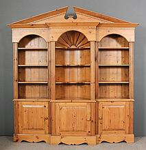 A 20th Century stripped pine break-front bookcase