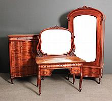 A Continental mahogany bedroom suite, on leaf