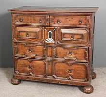 A 17th Century panelled oak chest of drawers,
