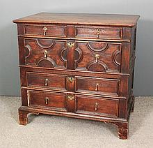 A 17th Century panelled oak chest of drawers with