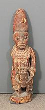 A 20th Century carved wooden Yoruba rider and