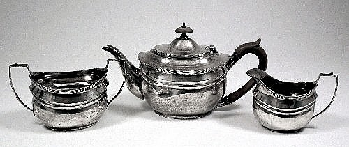 An Edward VIII silver three piece tea service of