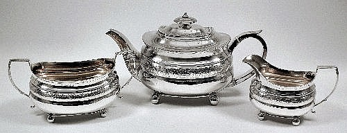 A George III silver three piece tea service, the