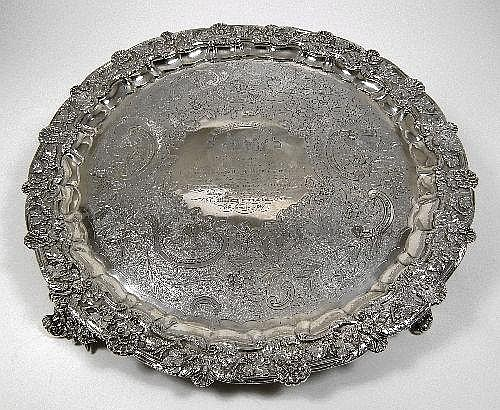 A good silver circular salver formed from a George