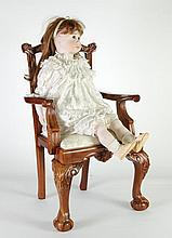 A MODERN BISQUE HEADED GIRL CHARACTER DOLL, with