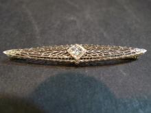 EDWARDIAN 14K WHITE GOLD DIAMOND PIN.
