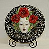 Hannd painted face plate in relief. D:15.75