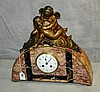 Antique French bronze and marble figural mantle clock.