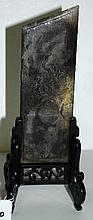 Chinese Han Dynasty carved jade burial plaque on carved hardwood stand.
