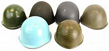 FIVE SURPLUS EUROPEAN MILITARY HELMETS