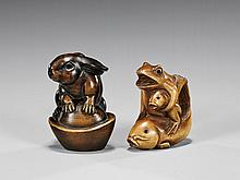 TWO CARVED WOOD ANIMAL NETSUKE