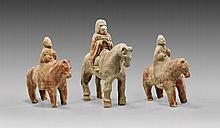 THREE HAN DYNASTY POTTERY HORSE & RIDERS