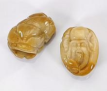 Two Carved Jade Pebbles: Shoulao & Qilin