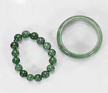 Two Chinese Carved Jade Bracelets