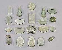 TWENTY CARVED JADE PENDANTS