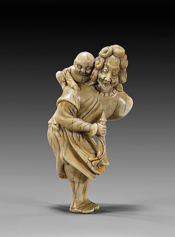 CARVED IVORY NETSUKE: Foreigner & Child