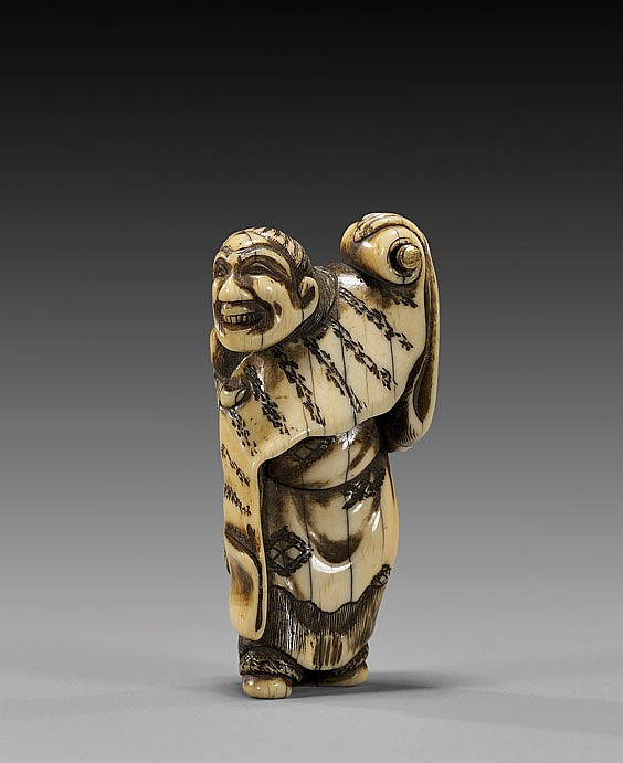 ANTIQUE IVORY NETSUKE: Man with Scroll