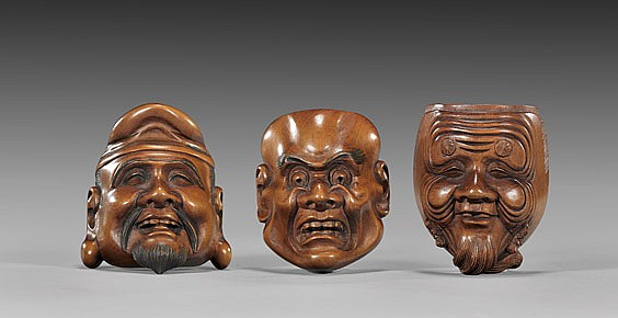 THREE CARVED WOOD MASK NETSUKE