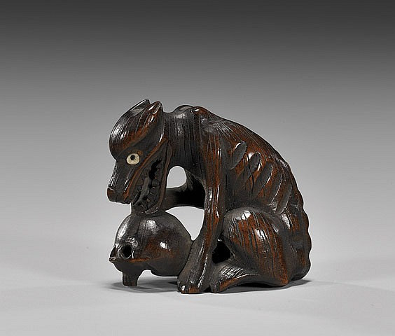 ANTIQUE WOOD NETSUKE: Wolf with Skull