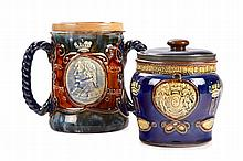 A 1905 CENTENARY ROYAL DOULTON TOBACCO JAR AND COVER
