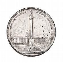 A WHITE METAL MEDALLION COMMEMORATING THE COMPLETION OF NELSON'S COLUMN IN 1843