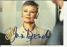 Judi Dench signed small James Bond colour card/photo. Good condition