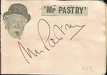 Mr Pastry signature piece fixed to Autograph album page with small inset b/w photo. Reg Varney signed on reverse.