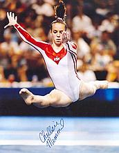 Memmel, Chellsie. 50cm x 40.5cm high quality colour photograph autographed by Chellsie Memmel, the famous US gymnast and 2005 World All-Around Champio