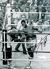 Larry Holmes boxing champion Signed 16 X 12 photo.