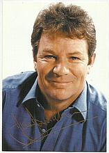 Jim Davidson signed colour 6x4 photo, attached to