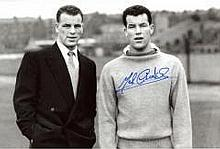 MEL CHARLES: B&W; 8x12 photo signed by former Arsenal star Mel Charles pictured alongside his brother, the legendary John Charles. Good condition