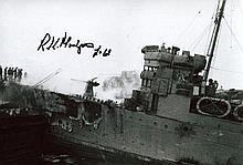 St NAZAIRE COMMANDO BOB MONTGOMERY: 8x12 inch photograph of HMS Campbeltown after being rammed into the docks at St Nazaire signed by veteran of the raid, Bob Montgomery MC. Montgomery was a Captain in the Royal Engineers attached to the Special
