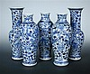 A garniture of five late 19th century blue and white vases,