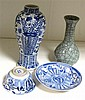A blue and white vase, a tea bowl and saucer and a Guan celadon vase,