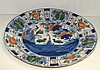 A mid 18th century Dutch Delft polychrome dish