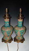 Attributed to early 20th century Longwy, a pair of brass mounted pottery vase/lamps,