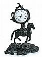 A 19th century bronze mantel timepiece,