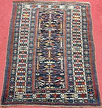A Caucasian wool rug,