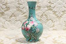 A tall Chinese porcelain vase with floral